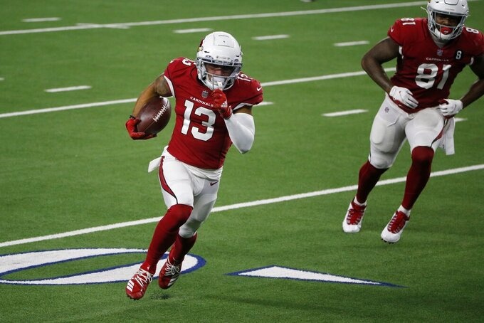 Arizona Cardinals wide receiver Christian Kirk (13) sprints to the end zone for a touchdown followed by Darrell Daniels (81) in the first half of an NFL football game against the Dallas Cowboys in Arlington, Texas, Monday, Oct. 19, 2020. (AP Photo/Michael Ainsworth)