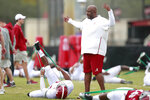 Alabama offensive coordinator Mike Locksley talks to Alabama running back Damien Harris during an NCAA college football practice on Wednesday, Dec. 26, 2018, in Miami Shores, Fla. Alabama plays Oklahoma in the Orange Bowl on Dec. 29. (AP Photo/Brynn Anderson)