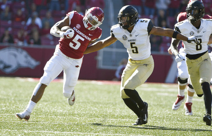 Arkansas running back Rakeem Boyd tries to shake Vanderbilt defender LaDarius Wiley in the first half of an NCAA college football game Saturday, Oct. 27, 2018, in Fayetteville, Ark. (AP Photo/Michael Woods)