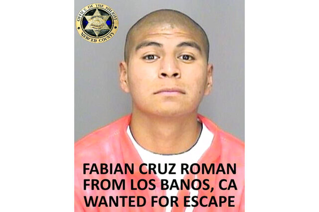 FILE - In this undated file photo, released by the Merced County Sheriff's Office, is inmate Fabian Cruz Roman, from Los Banos, Calif. Two of six inmates who escaped from a jail in central California over the weekend were arrested near the border with Mexico hours after another escapee was nabbed west of Fresno, authorities said Wednesday, Jan. 13, 2021. Fabian Cruz Roman, 22, and Andres Nunez Rodriguez, 21, were captured Tuesday, Jan, 12, south of San Diego, a spokesman with Merced County Sheriff's Office said. (Merced County Sheriff's Office via AP, File)