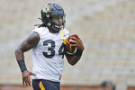 Missouri running back Larry Rountree III runs with the ball during an NCAA college football practice Monday, Aug. 12, 2019, in Columbia, Mo. (AP Photo/Jeff Roberson)