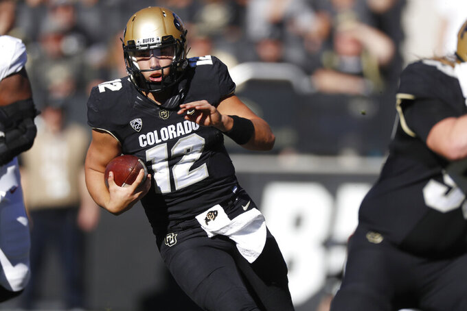 Colorado quarterback Steven Montez runs for a short gain against Stanford in the first half of an NCAA college football game Saturday, Nov. 9, 2019, in Boulder, Colo. (AP Photo/David Zalubowski)
