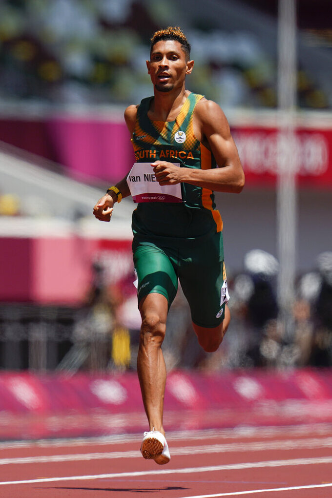 Wayde Van Niekerk, of South Africa, runs in a heat in the men's 400-meter run at the 2020 Summer Olympics, Sunday, Aug. 1, 2021, in Tokyo. (AP Photo/Petr David Josek)