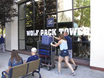 In this photo taken Thursday, Aug. 22, 2019, a student moves in to a Circus Circus casino-hotel tower that has been renamed Wolf Pack Tower in downtown Reno, Nev. It will house about 1,300 University of Nevada, Reno students for the coming school year after a July gas explosion shut down the two largest dorms on the main campus a half-mile away. (AP Photo/Scott Sonner)
