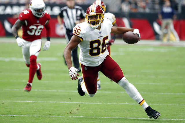 FILE - In this Sept. 9, 2018, file photo, Washington Redskins tight end Jordan Reed (86) runs with the ball during an NFL football game against the Arizona Cardinals in Glendale, Ariz. The San Francisco 49ers have agreed on a one-year contract with Jordan. (AP Photo/Rick Scuteri, File)