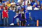 Minnesota Vikings running back Ameer Abdullah, left, scores a touchdown with Buffalo Bills defensive back Abraham Wallace (35) defending during the first half of an NFL preseason football game in Orchard Park, N.Y., Thursday, Aug. 29, 2019. (AP Photo/Adrian Kraus)