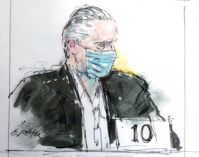 FILE- In this Oct 16, 2020 courtroom drawing, former Mexican defense secretary Gen. Salvador Cienfuegos appears in federal court in Los Angeles. Cienfuegos, who led Mexico's army for six years under ex-President Enrique Peña Nieto, pleaded not guilty to U.S. drug trafficking and money laundering charges via remote appearance on Thursday, Nov. 5, 2020, in federal court in New York City.(Bill Robles via AP, File)