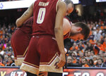 Boston College's Nik Popovic, center, is helped off the court after being injured during the second half of an NCAA college basketball game against Syracuse in Syracuse, N.Y., Saturday, Feb. 9, 2019. Syracuse won 67-56. (AP Photo/Nick Lisi)