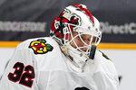 Chicago Blackhawks goaltender Kevin Lankinen blocks a shot against the Nashville Predators in the second period of an NHL hockey game Wednesday, Jan. 27, 2021, in Nashville, Tenn. (AP Photo/Mark Humphrey)
