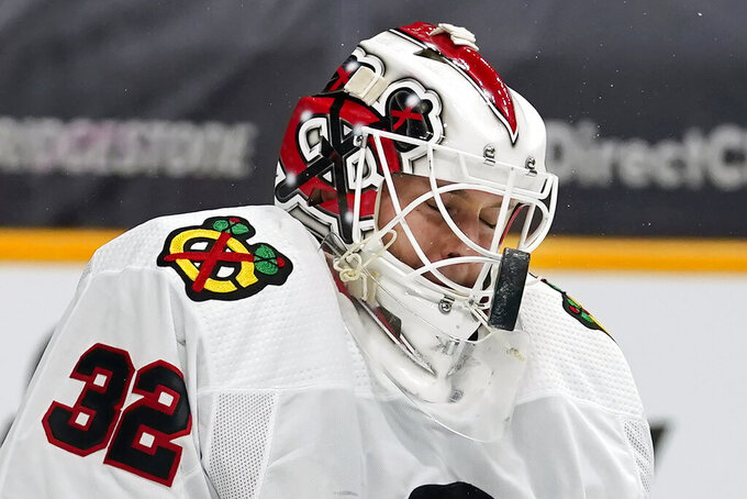 Chicago Blackhawks goaltender Kevin Lankinen blocks a shot against the Nashville Predators in the second period of an NHL hockey game Wednesday, Jan. 27, 2021, in Nashville, Tenn. (AP Photo/Mark Humphrey)