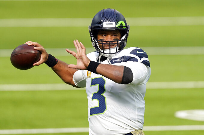 FILE - In this Sunday, Nov. 15, 2020 file photo, Seattle Seahawks quarterback Russell Wilson (3) warms up before an NFL football game against the Los Angeles Rams in Inglewood, Calif. Seattle Seahawks coach Pete Carroll and general manager John Schneider spend Wednesday, April 28, 2021 talking about their relationship with their starting quarterback, the result of months of silence on the subject and the fact they have just three picks in the NFL draft. (AP Photo/Ashley Landis, File)