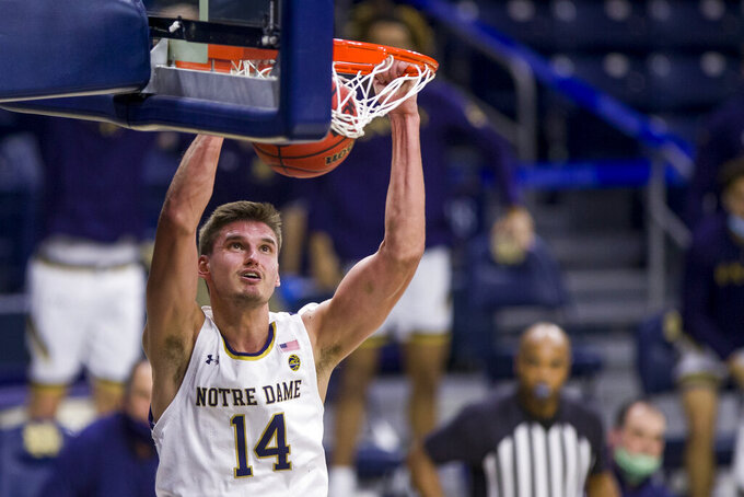 Notre Dame's Nate Laszewski (14) dunks during the second half of an NCAA college basketball game against Wake Forest on Tuesday, Feb. 2, 2021, in South Bend, Ind. Notre Dame won 79-58. (AP Photo/Robert Franklin)