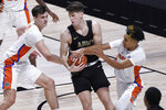 Army's Nick Finke, center, is pressured by Florida's Colin Castleton, left, and Tre Mann, right, in the first half of an NCAA college basketball game, Wednesday, Dec. 2, 2020, in Uncasville, Conn. (AP Photo/Jessica Hill)