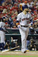 Houston Astros' Robinson Chirinos watches his two-run home run during the fourth inning of Game 4 of the baseball World Series against the Washington Nationals Saturday, Oct. 26, 2019, in Washington. (AP Photo/Jeff Roberson)