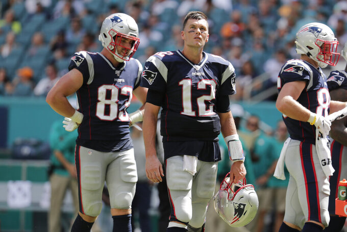 New England Patriots quarterback Tom Brady (12) look up at the scoreboard, during the second half at an NFL football game against the Miami Dolphins, Sunday, Sept. 15, 2019, in Miami Gardens, Fla. (AP Photo/Lynne Sladky)