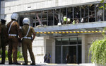 Police and forensic officials inspect a blast spot at the Shangri-la hotel in Colombo, Sri Lanka, Sunday, April 21, 2019. More than hundred people were killed and hundreds more hospitalized from injuries in near simultaneous blasts that rocked three churches and three luxury hotels in Sri Lanka on Easter Sunday, a security official told The Associated Press, in the biggest violence in the South Asian country since its civil war ended a decade ago.(AP Photo/Eranga Jayawardena)