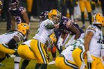 Green Bay Packers' Aaron Rodgers calls a play during the second half of an NFL football game against the Chicago Bears Sunday, Jan. 3, 2021, in Chicago. (AP Photo/Nam Y. Huh)