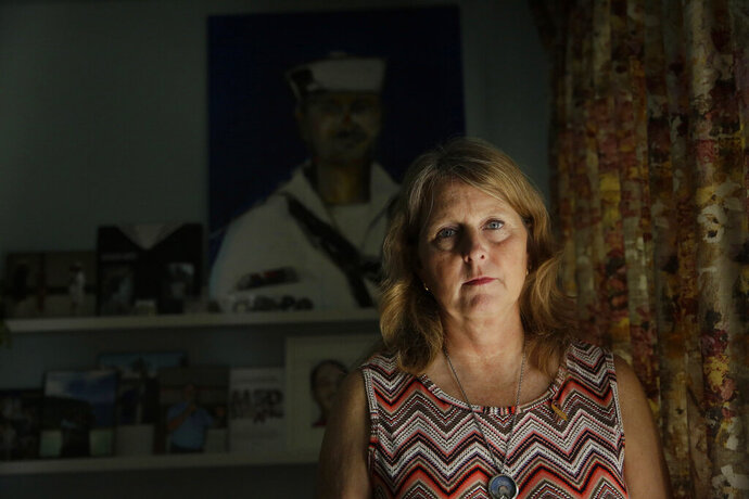 Debbi Hixon, poses for a portrait on Friday, Feb. 14, 2020, in Hollywood, Fla. Hixon is the the widow of Parkland victim, Chris Hixon, a former athletic director and military veteran, killed in the school shooting on Valentine's Day two years ago at Marjory Stoneman Douglas High School. Her home was recently renovated by the program