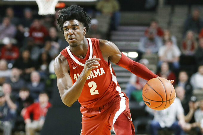 FILE - In this Jan. 22, 2020, file photo, Alabama guard Kira Lewis Jr. plays against Vanderbilt in the first half of an NCAA college basketball game in Nashville, Tenn. Lewis Jr. was selected to the Associated Press All-SEC first team announced Tuesday, March 10, 2020.  (AP Photo/Mark Humphrey, File)