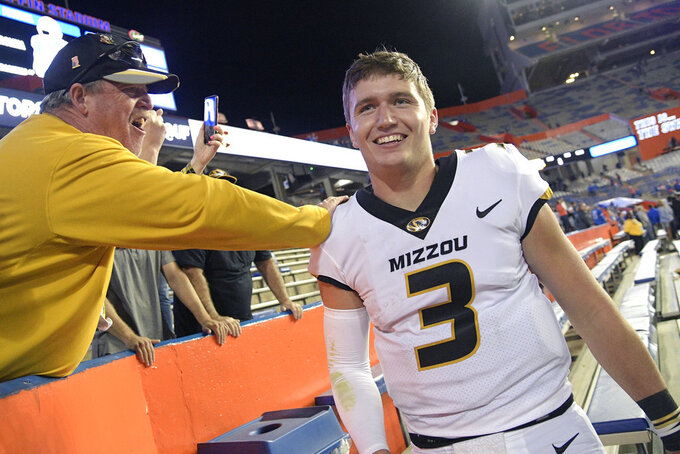 Missouri quarterback Drew Lock (3) is congratulated by fans in the stands after an NCAA college football game against Florida, Saturday, Nov. 3, 2018, in Gainesville, Fla. (AP Photo/Phelan M. Ebenhack)