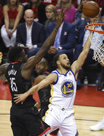 Golden State Warriors guard Stephen Curry (30) drives to the basket as Houston Rockets center Clint Capela (15) defends during the first half of Game 2 of the NBA basketball playoffs Western Conference finals Wednesday, May 16, 2018, in Houston. (AP Photo/Eric Christian Smith)