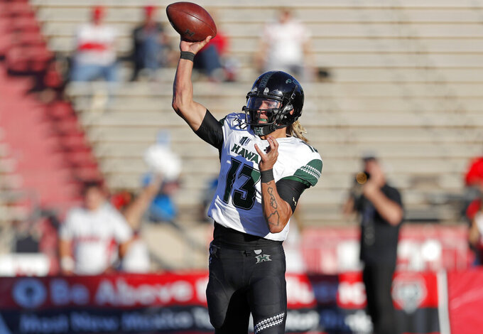 Hawaii quarterback Cole McDonald (13) throws against New Mexico during the second half of an NCAA college football game Saturday, Oct. 26, 2019, in Albuquerque, N.M. (AP Photo/Andres Leighton)