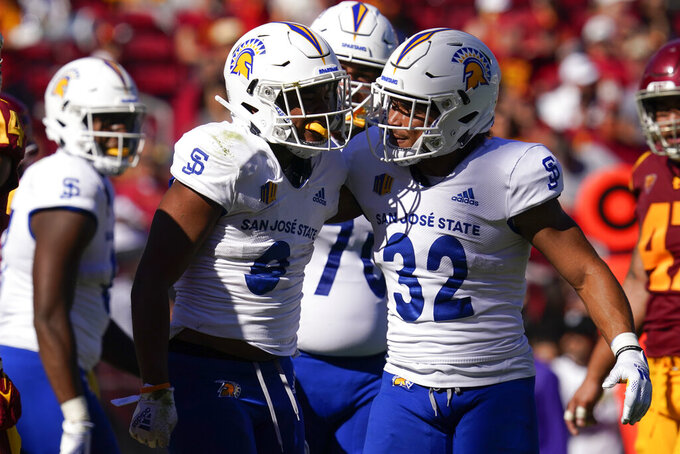 San Jose State wide receiver Isaiah Hamilton (9) and running back Kairee Robinson (32) react after a play during the second half of an NCAA college football game against Southern California Saturday, Sept. 4, 2021, in Los Angeles. (AP Photo/Ashley Landis)