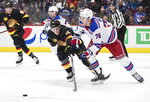 Vancouver Canucks' Jake Virtanen (18) reaches for the puck as New York Rangers' Brady Skjei (76) passes it during the second period of an NHL hockey game Saturday, Jan. 4, 2020, in Vancouver, British Columbia. (Darryl Dyck/The Canadian Press via AP)