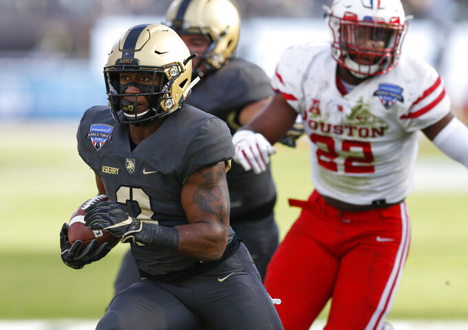 Army running back Jordan Asberry (3) rushes the ball past Houston linebacker Austin Robinson (22) during the first half of Armed Forces Bowl NCAA college football game Saturday, Dec. 22, 2018, in Fort Worth, Texas. (AP Photo/Jim Cowsert)