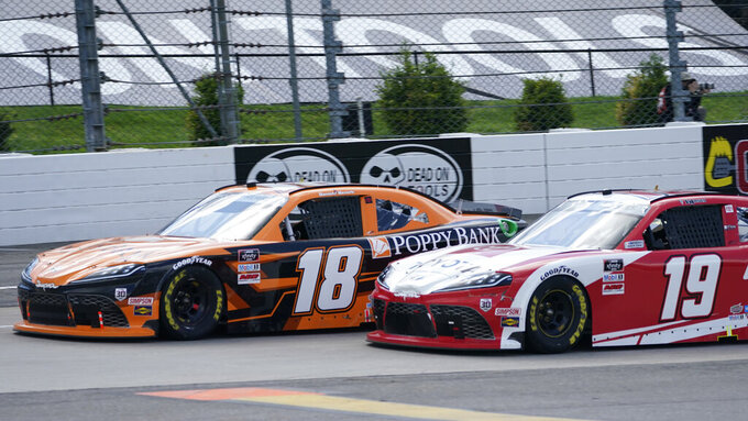 Daniel Hemric (18) and Brandon Jones (19) lead the field at the restart of the rain delayed NASCAR Xfinity Series auto race at Martinsville Speedway in Martinsville, Va., Sunday, April 11, 2021. (AP Photo/Steve Helber)