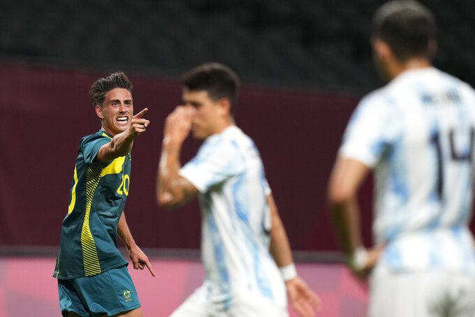 Australia's Lachlan Wales celebrates scoring his side's opening goal against Argentina during a men's soccer match at the 2020 Summer Olympics, Thursday, July 22, 2021, in Sapporo, Japan. (AP Photo/SIlvia Izquierdo)