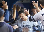 New York Yankees' Gio Urshela celebrates with teammates after hitting his second two-run home run of the night, against the Toronto Blue Jays during the third inning of a baseball game Thursday, Aug. 8, 2019, in Toronto. (Fred Thornhill/The Canadian Press via AP)
