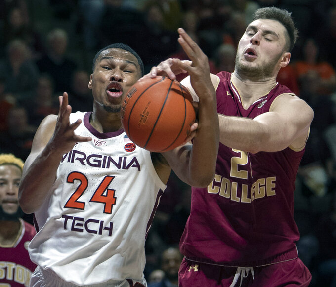 Virginia Tech forward Kerry Blackshear Jr. (24) battles Boston College forward Nik Popovic (21) for a loose ball during the second half of an NCAA college basketball game Saturday, Jan. 5, 2019, in Blacksburg, Va. Va. Tech won 77-66. (AP Photo/Don Petersen)