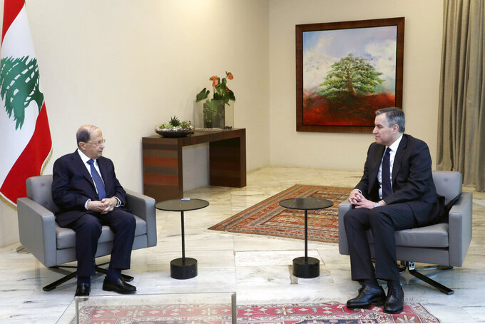 In this photo released by Lebanon's official government photographer Dalati Nohra, Lebanese President Michel Aoun, left, meets with Lebanese Prime Minister-designate Mustapha Adib, at the Presidential Palace in Baabda, east of Beirut, Lebanon, Saturday, Sept. 26, 2020. Adib has resigned Saturday amid a political impasse over government formation, nearly a month after he was appointed to the job. The announced by Adib deals a blow to French President Emmanuel Macron's efforts to break a dangerous stalemate in the crisis-hit country. (Dalati Nohra/Lebanese Government via AP)