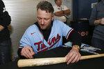 Minnesota Twins' Josh Donaldson autographs a bat at the baseball team's TwinsFest, Friday, Jan. 24, 2020, in Minneapolis. (AP Photo/Stacy Bengs)