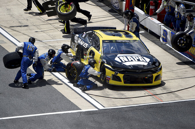 Chase Elliott (9) pits during the NASCAR Cup Series auto race, Monday, May 6, 2019, at Dover International Speedway in Dover, Del. (AP Photo/Will Newton)
