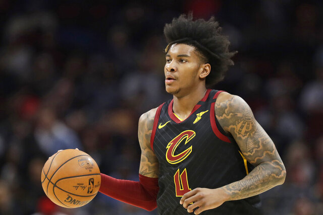 FILE - Cleveland Cavaliers' Kevin Porter Jr. drives against the Philadelphia 76ers in the first half of an NBA basketball game in Cleveland, in this Wednesday, Feb. 26, 2020, file photo. The Cavaliers are moving on from troubled and talented forward Kevin Porter Jr., a person familiar with his standing with the team told the Associated Press on Monday, Jan. 18, 2021. The Cavs will either trade or release Porter, who has not played for them this season, said the person who spoke on condition of anonymity because of the sensitivity of the situation. (AP Photo/Tony Dejak, File)