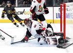 Ottawa Senators goaltender Anders Nilsson (31) defends against the Vegas Golden Knights during the second period of an NHL hockey game Thursday, Oct. 17, 2019, in Las Vegas. (AP Photo/David Becker)