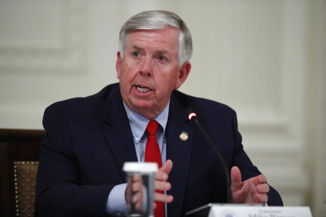 FILE - In this July 7, 2020, file photo, Missouri Gov. Mike Parson speaks during an event at the White House, in Washington. Missouri voters are set to decide whether to expand Medicaid health care coverage to thousands more low-income adults. A proposal to amend the state Constitution to expand eligibility for Medicaid is on Tuesday, Aug. 4, 2020s' ballot. Parson, who opposes Medicaid expansion and is up for election this year, in May moved the vote on the proposal up from the Nov. 3 general election to Tuesday's primary. (AP Photo/Alex Brandon, File)