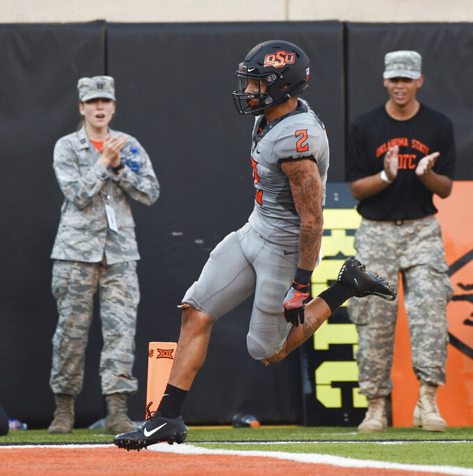Oklahoma State wide receiver, Tylan Wallace, scores a touchdown during the first half of an NCAA college football game against McNeese in Stillwater, Okla., Saturday, Sept. 7, 2019. (AP Photo/Brody Schmidt)