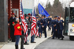 Members of the U.S. Air Force arrive for a memorial service for U.S. Air Force Staff Sgt. Dylan J. Elchin on Thursday, Dec. 6, 2018, in Moon Township, Pa. Elchin was one of three servicemen killed last month when their vehicle was destroyed by an improvised explosive device in Andar, in Afghanistan's Ghazni Province. (AP Photo/Keith Srakocic)