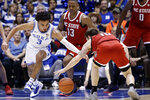 Duke guard Tre Jones (3) and North Carolina State guard Braxton Beverly (10) reach for a loose ball during the first half of an NCAA college basketball game in Durham, N.C., Monday, March 2, 2020. North Carolina State guard C.J. Bryce (13) looks on at rear. (AP Photo/Gerry Broome)