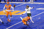 Colorado State punter Ryan Stonehouse (41) has a punt blocked for the second of the night, this time by Boise State cornerback Avery Williams (26), during the first half of an NCAA college football game Thursday, Nov. 12, 2020, in Boise, Idaho. (AP Photo/Steve Conner)