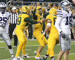 Baylor placekicker John Mayers (95), center, reacts as his teammates celebrate after his winning kick against Kansas State in the second half of an NCAA college football game, Saturday, Nov. 28, 2020, in Waco, Texas. (Jerry Larson/Waco Tribune-Herald via AP)