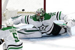 Dallas Stars goaltender Anton Khudobin gives up a goal to Chicago Blackhawks left wing Alex DeBrincat during the first period of an NHL hockey game in Chicago, Sunday, May 9, 2021. (AP Photo/Nam Y. Huh)