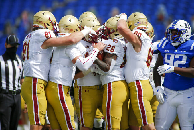 Boston College running back David Bailey (26) celebrates with teammates after rushins for a touchdown against Duke during the first half of an NCAA college football game, Saturday, Sept. 19, 2020, in Durham, N.C. (Nell Redmond/Pool Photo via AP)