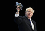 Conservative party leadership candidate Boris Johnson holds up a Jewish kippah during his speech during a Conservative leadership hustings at ExCel Centre in London, Wednesday, July 17, 2019. The two contenders, Jeremy Hunt and Boris Johnson are competing for votes from party members, with the winner replacing Prime Minister Theresa May as party leader and Prime Minister of Britain's ruling Conservative Party. (AP Photo/Frank Augstein)