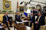 President Donald Trump meets with Polish President Andrzej Duda in the Oval Office of the White House, Wednesday, June 24, 2020, in Washington, as Vice President Mike Pence and Secretary of State Mike Pompeo, right, listen. (AP Photo/Evan Vucci)