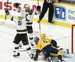 Los Angeles Kings right wing Dustin Brown (23) and left wing Alex Iafallo, top, celebrate after Iafallo scored a goal against the Nashville Predators during the first period of an NHL hockey game Saturday, Nov. 17, 2018, in Nashville, Tenn. (AP Photo/Mark Zaleski)