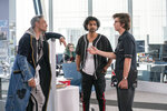 """This image released by 20th Century Studios shows Taika Waititi, from left, Utkarsh Ambudkar and Joe Keery in a scene from """"Free Guy."""" (Alan Markfield/20th Century Studios via AP)"""